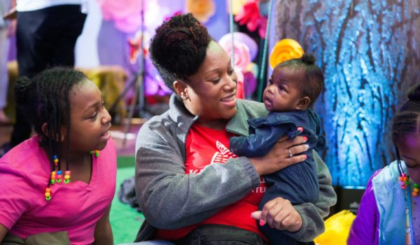 A KinderCare team member engages an infant in the Infant Sensory Area