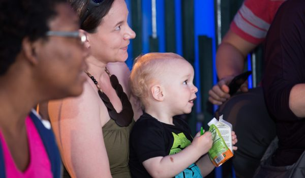 Mom and baby enjoy live music