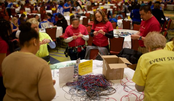 Volunteers make paracord bracelets for Operation Gratitude